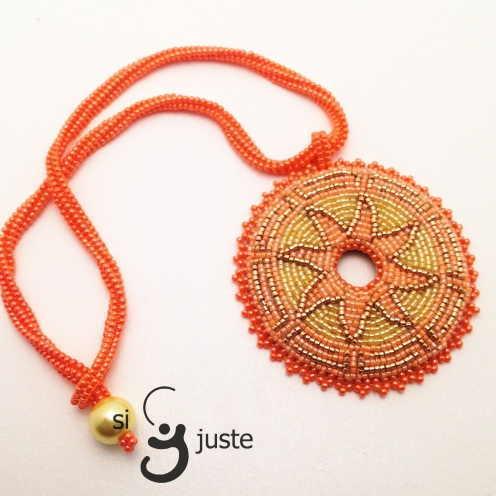 One of a kind beaded beautiful handmade necklace with pendant inspired by Aztecs Sun will be great complement to any creation. My jewellery will give you unique look and style. It is also a perfect gift for someone special. If you like to stand out and attract attention this piece of handmade jewellery made with love and passion is for you. Necklace and pendant are made out of small 2 mm Toho and Miyuki seed beads The length of the chain (necklace) is approximately 39 cm and the diameter of the pendant is about 7 cm. The back of the pendant is finished with fake leather in dark beige colour.